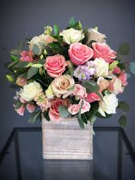 Box arrangement of pink roses, white roses, cream roses and foliage